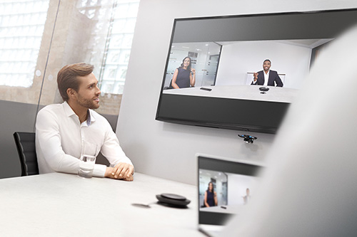 Video conferencing man at desk on call