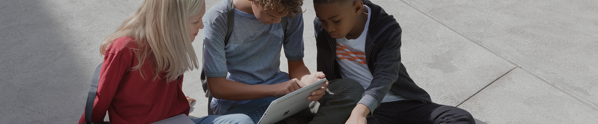 Students using Microsoft Surface device on the school yard