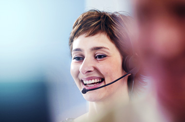 IT specialist on phone to customer