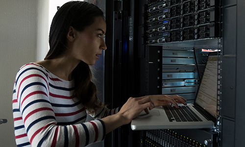 Female network engineer configuring Server